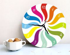 wall clock neon rainbow colorful curly geometric decor kitchen kids nursery children wall hanging wall decor home office gift. $49.00, via Etsy.