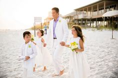 groom processional on the beach with his children, photo by sarahlyn.com