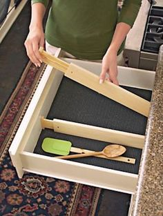50 Useful Kitchen Gadgets You Didnt Know Existed---I've been known to spend hours in the aisles of the Container Store. I can't help it if I like every nook and cranny in my home to be well organized! I bought a few of these adjustable drawer dividers for my kitchen drawers, and I love them! You can completely customize the size of each slot.