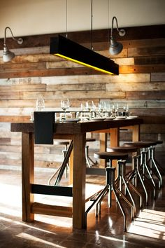 Steel and wood high table/Linear steel light fixture
