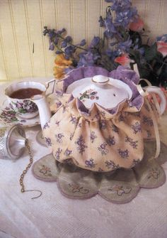 An old fashioned tea pot cozy pattern with embroidery embellishment / Lyn's Fine Needlework