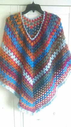Check out this item in my Etsy shop https://www.etsy.com/listing/270464602/colorful-poncho-with-shell-border