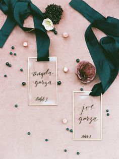 acrylic seating cards strung from black ribbon | Photography: Charla Storey