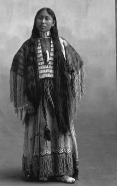 A pic of a Cheyenne woman, Woxie Haury, in a ceremonial dress. The Native American dress is made from three different hides: 1 worn as a poncho on top with 2 sewn together for the skirt. The dresses were sewn by hand using porcupine quills as needles. Native American Beauty, Native American Photos, Native American Tribes, American Indian Art, Native American History, American Indians, Native Americans, African History, American Symbols