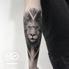 cosmic lion tattoo on the forearm