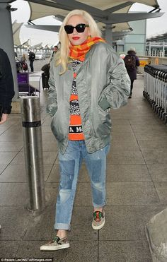 Pure jeanius: Gwen Stefani wore a colorful sweater and scarf plus a silky bomber jacket and distressed denim as she turned up at London's Heathrow Airport for a flight to Dubai Saturday Gwen Stefani And Blake, Gwen Stefani Style, Grey Bomber Jacket, Heathrow Airport, Love Jeans, Edgy Style, Blake Shelton, Kate Bosworth, Jets