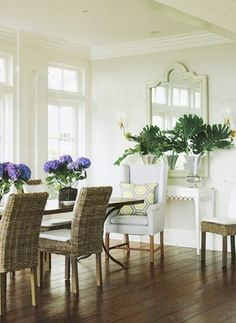 I have these wicker chairs. But love how they did the hydrangeas in glass.