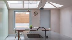 Simon Astridge adds dusty-pink concrete extension to north London house