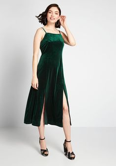 Material Girl Velvet Midi Dress - Don't settle for less—go 'awe' out with this emerald green midi dress! Sultry, feminine features—cami straps, princess seams, and thigh-high slits—make this velvet beauty by Louche anything but ordinary.