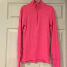 Under Armour Fitted Cold Gear Pullover Great Condition Under Armour Fitted Cold Gear 1/4 Zip Pullover! Tiny hole by collar where theft tag was removed when purchased! Otherwise no stains,rips,tears etc.... Thumb holes and side zipper pocket! Under Armour Jackets & Coats