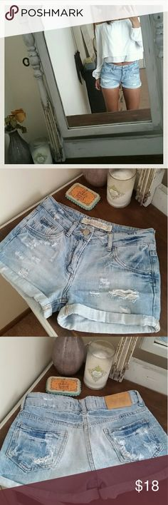 Zara denim shorts Distressed midrise denim shorts from Zara in light wash. Have been worn several times but good condition. One small discoloration on the back left side but it's very hard to notice unless you're looking for it. Zara tends to run small. Best fits: 00/0, 24,25 best Zara Shorts Jean Shorts