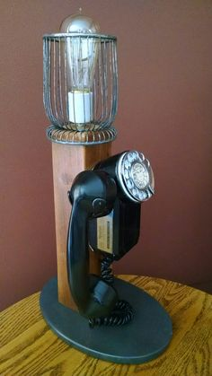 """great looking vintage accent light with a classic rotary phone and neat """"edison"""" style bulb.... https://www.facebook.com/pages/Skramstad-Primitives/340184592831655?ref=bookmarks"""