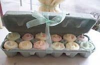 Mini cupcakes put into an egg carton.