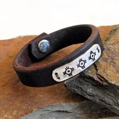 Sterling Silver and Leather Cuff Bracelet - Native American Symbol - Vintage Reins - Handmade Silver and Leather - Roca Jewelry Designs by RocaJewelryDesigns on Etsy https://www.etsy.com/listing/271244670/sterling-silver-and-leather-cuff