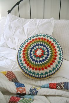 Peek at my bed with my DS quilt and pretty hand crocheted pillow, courtesy of my BFF.