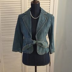Banana republic size 4 denim jacket Gently used size 4 Banana Republic denim jacket.  Cute details like the front tie and details on the sleeves (see photos).  Timeless denim jacket! Banana Republic Jackets & Coats Jean Jackets