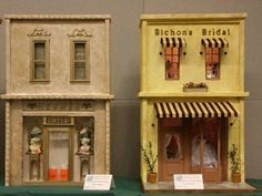 Identical 1:12 scale shop fronts with different decorative treatments and finishes.