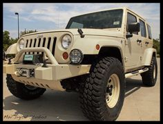 LOVE the color keyed fenders and bumper!  Sahara Tan Jeep Wrangler Unlimited