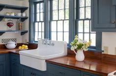 Kitchen with slate blue painted woodwork