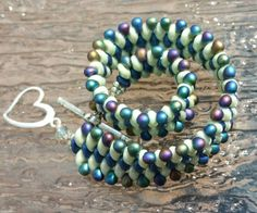 Check out this item in my Etsy shop https://www.etsy.com/listing/235293578/striking-mint-and-blue-super-duo