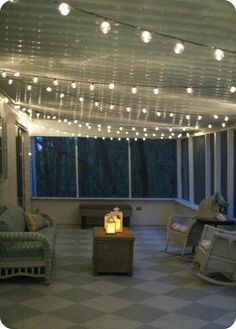 Simple screened porch light - outdoor string lights make everything look pretty and are easy to install.