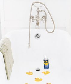 Hard-to-remove decals stuck on the tub? All you need is 15 minutes, some WD-40, a credit card, and dishwashing soap.