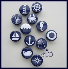 The base of these drawer knobs are hand painted navy with nautical prints added to the top. Colors are navy and white.