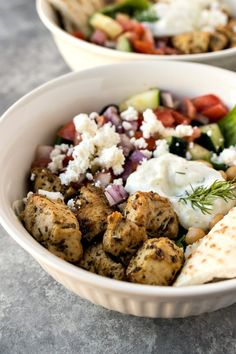 Mixed greens are topped with Greek chicken, chickpeas, tomato cucumber salad, feta cheese, and a homemade tzatziki sauce. Chicken Gyro Recipe, Chicken Gyros, Chicken Recipes, Marinade Chicken, Salad Chicken, Healthy Chicken, Cooking Ingredients, Cooking Recipes, Healthy Recipes