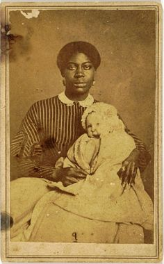 """CDV of a well dressed female slave holding a baby on her lap, """"T.M. Schleier, Nashville, Tennessee."""""""