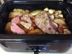 Use Roaster, delicious! Layer veggies in roaster, place corned beef on top. Sprinkle with seasonings that camr with corned beef. Cover with about 1/2 cup brown sugar. Pour 1-2 dark beers over it. Put enough water to go half-way up side of corned beef. Cook at 250 degrees for about 4 hours (for 4lb beef).