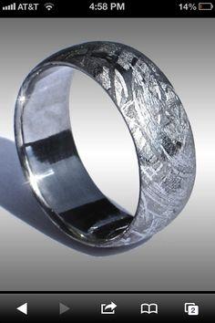 Meteorite wedding band. http://www.arizonaskiesmeteorites.com/Damascus_Rings_Meteorite_Rings/Meteorite_Rings/index.html