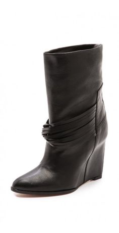 DETHRO WEDGE BOOTS $129.10 A covered, sculpted wedge heel and playful fringe lend drama to buttery leather IRO boots. Pointed toe. Leather sole.