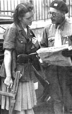 Photographed at the time of the German surrender in Paris, two resistance fighters study a copy of the underground newspaper L'Espoir. The first lieutenant displays his two rank bars on his beret. The resistante, carrying both a rifle and a Thompson...pin by Paolo Marzioli
