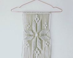 Macrame wall hanging made with 100% cotton braided rope on wood branch.  Approximately 30cm x 40cm  Only one available.