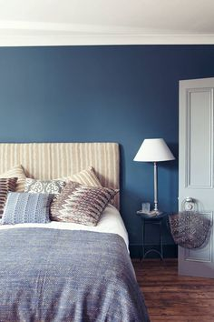 Discover bedroom design ideas on HOUSE - design, food and travel by House & Garden including this elegant combination of deep blue walls and oatmeal coloured stripes. Blue Bedroom Paint, Headboard Designs, Beautiful Bedrooms, Home, Dulux Paint Colours Blue, Blue Bedroom Walls, Bedroom Design, Room Colors, House Colors