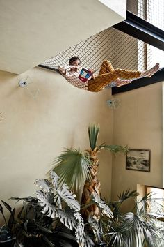 I want a hammock in my house! Joris Brouwers and Nicky Zwaan's Amsterdam home built constructed of concrete floors, clay walls, OSB staircase, window light and a plant jungle