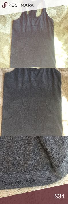 Lululemon Athletica Charcoal Gray Run Swiftly, 8 Excellent preowned condition, size 8, charcoal gray   Size 8. Care tag taken out for comfort but hem shows size. lululemon athletica Tops Tank Tops