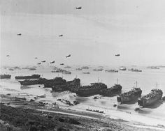 Landing Ships Tank (LST) land invasion supplies on Omaha Beach, shortly after the 6 June 1944 D-Day assault [3600 x 2873]