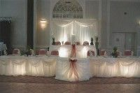 Head table. I like the lighting under the white tablecloths...