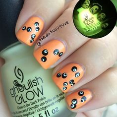 Halloween Nail Art. Orange is #SallyHansen 'Dreamsicle' and the spooky eyes were done with @chinaglazeofficial 'Liquid Leather' and 'White on White' and I topped the orange base and the whites of the eyes with 1 coat of #ChinaGlaze 'Ghoulish Glow'
