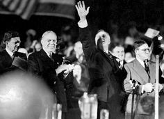 """Franklin D. Roosevelt waves during a rally at Chicago Stadium on Oct. 14, 1936, where he defended his New Deal policies by saying """"the train of American business is moving ahead."""" Less than a month later, he defeated Kansas Governor Alfred Landon in a landslide for his second term in office."""