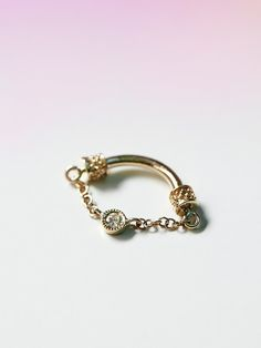 Venus by Maria Tash Diamond Septum Spinner at Free People Clothing Boutique