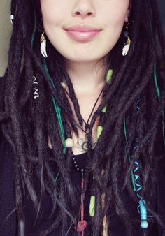 I love this picture and her dreads are perfect with those hair accessories she pinned on.