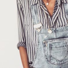 Love the overalls over the striped button down.