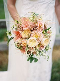 Pretty coral-colored blooms like dahlias, amaryllises, astilbe, and garden roses make such an elegant combination.