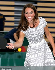 Princess of ping pong: The Duchess of Cambridge plays table tennis as she visits Bacon's College to launch the Coach Core programme today. July 26, 2012