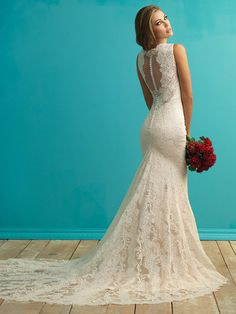 Allure 9253 This trailing lace gown features an illusion back framed by…