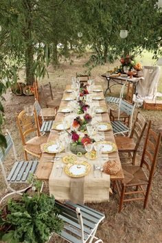 Dining al fresco- mix of chairs, table runner, flowers