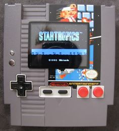 The hand-held NES in a cartridge