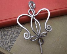 Aluminum Celtic Angel Heart Shawl Pin, Scarf Pin, Sweater Brooch - Light Weight - Celtic Knot - Knitting, Fashion Accessories by nicholasandfelice on Etsy https://www.etsy.com/listing/122385073/aluminum-celtic-angel-heart-shawl-pin